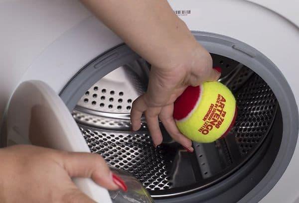 can you put tennis ball in washing machine
